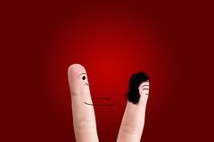 Couple in quarrel. Painted at fingers isolated on red background Stock Image