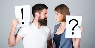 Couple in quarrel. Question mark. A woman and a man a question, exclamation point. Quarrel between two people. Pensive stock photography