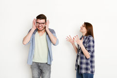 Couple in quarrel, woman shouting to boyfriend Royalty Free Stock Photos