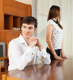 Couple after quarrel. Young couple after quarrel at home Stock Image