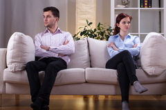Couple after quarrel. Young couple sitting on the sofa after quarrel Royalty Free Stock Image