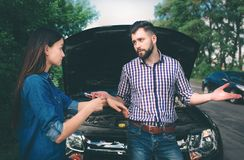 The couple quarreled, the car broke down on the road royalty free stock photography