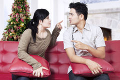Couple quarreling on sofa in christmas day Royalty Free Stock Photos