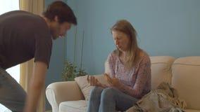 The couple quarrels, husband snatches a magazine
