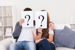 Couple with question marks Stock Photography