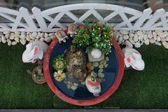 Couple rabbits and friends in garden. View from above. Stock Photos