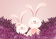A couple of rabbits with leaves Stock Photo