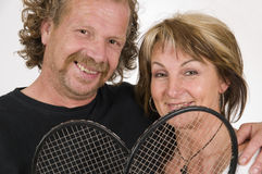 Couple with racquets Royalty Free Stock Image
