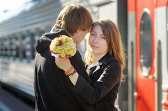 Couple on railway station platform Stock Image