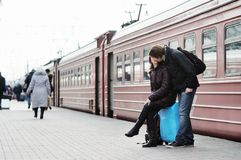 Couple on railway station platform Royalty Free Stock Image
