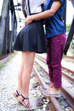 Couple at railway track Stock Photo