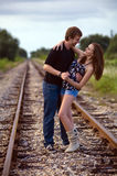 Couple on railway tracks royalty free stock photography