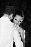 Couple in the rain. Portrait of the young couple in the rain Royalty Free Stock Photography