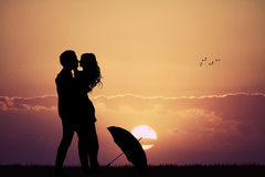 Couple in the rain at sunset Royalty Free Stock Photography