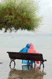 Couple on a Rainy Day. A couple dressed in raincoats (unrecognizable) in the rain Royalty Free Stock Image