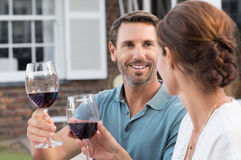 Couple raising toast Stock Photo