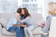 Couple reaching break through in therapy session Stock Image