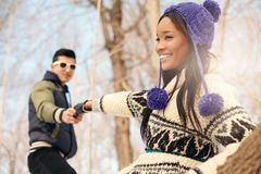 Free Couple Reaching Out While Hiking In The Snow In Winter Stock Images - 160755224