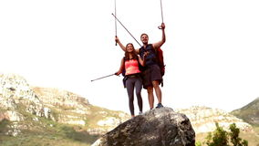 Couple reaching the top of their hike stock video