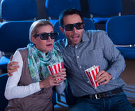 Couple reacting to a 3D movie Stock Photo