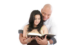 Couple reading the Bible. Attractive couple reading the Bible stock photos