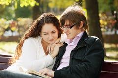 Couple reading book Stock Photo