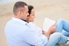 Couple reading book Stock Photos