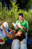 Couple reading a book Royalty Free Stock Image
