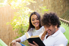 Couple reading book on hammok Royalty Free Stock Photography