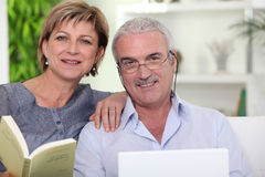 Couple reading and browsing Royalty Free Stock Photo