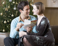 A couple reading Christmas cards Royalty Free Stock Photography