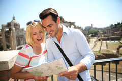Couple reading city map in Rome Stock Image