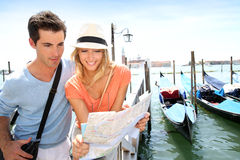 Couple reading city map of Venice Stock Photography