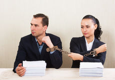 Couple reading a contract. Couple with chained hands reading a contract, concept Royalty Free Stock Image