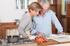 Couple reading a cookbook Royalty Free Stock Image