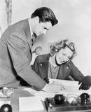 Couple reading a document together Royalty Free Stock Image