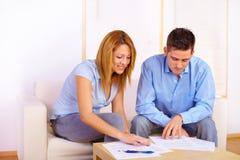 Couple reading documents Stock Photo