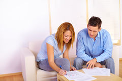 Couple reading documents Stock Image