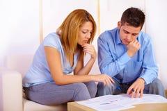 Couple reading documents Stock Photos