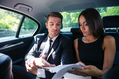 Couple reading documents in car Royalty Free Stock Photos