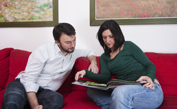 Couple Reading at Home Stock Photography