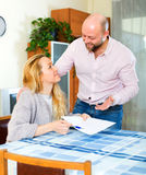 Couple reading insurance contract Royalty Free Stock Photo
