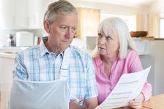 Couple Reading Letter About Husband`s Injury Stock Photos