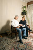 Couple Reading In Living Room-Vertical Royalty Free Stock Image