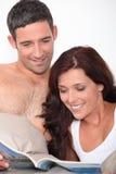 Couple reading magazine Royalty Free Stock Photo