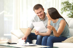 Free Couple Reading Mail At Home Royalty Free Stock Photography - 79881577