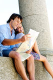 Couple reading map Royalty Free Stock Photography