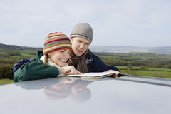 Couple Reading Map By Car In Countryside royalty free stock photo