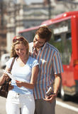 Couple Reading Map on London Street Stock Photos