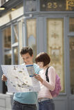 Couple Reading Map Outdoors Royalty Free Stock Image